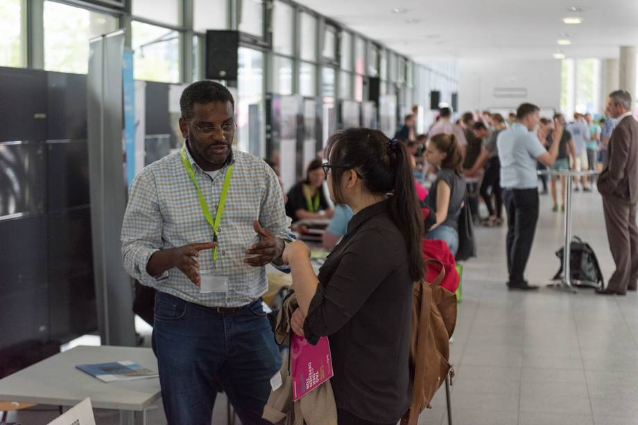 a BTU International Relations Office employee advises visitors during the open day