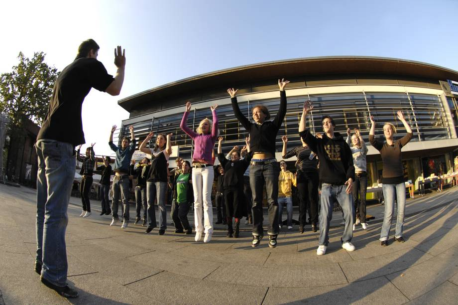 first semester students dance at a flash mob in Cottbus town centre