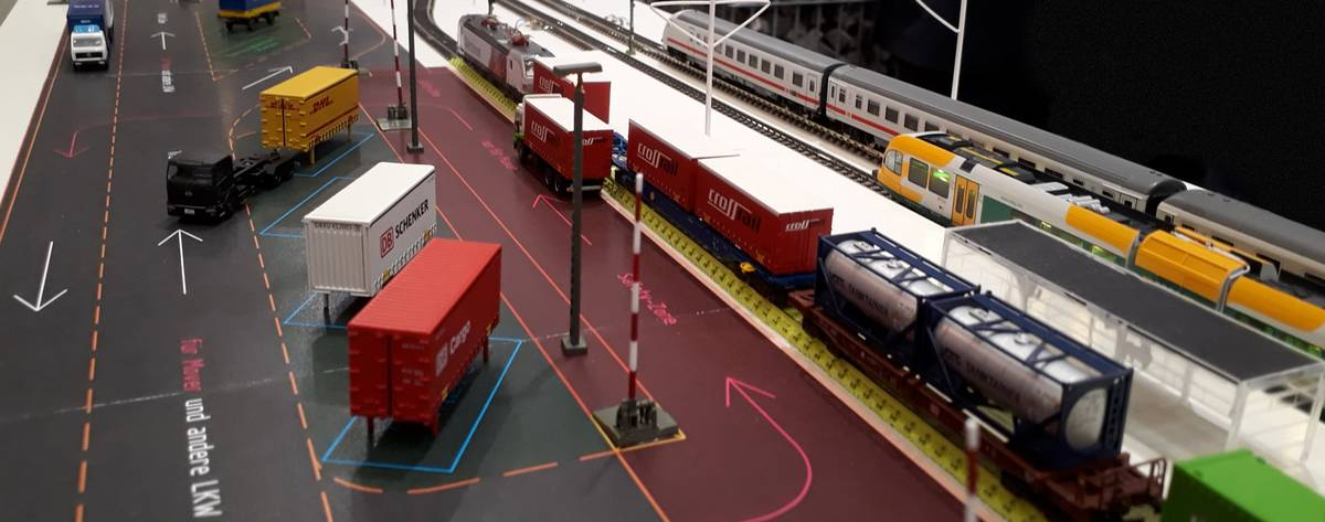 In a model, goods are loaded between truck and train.
