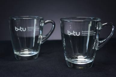 Glass cup with BTU logo