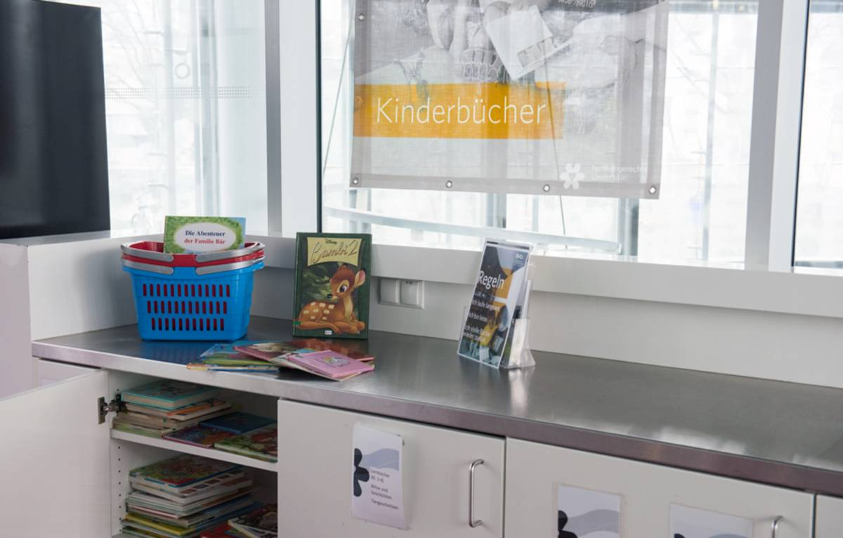 "As a ""family-friendly university"", we support students with children. In the cafeteria of the library at the Central Campus a reading corner and books for children of different age groups can be found."