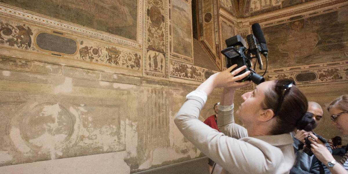 Doctoral students in the Heritage Studies programme examine antique murals