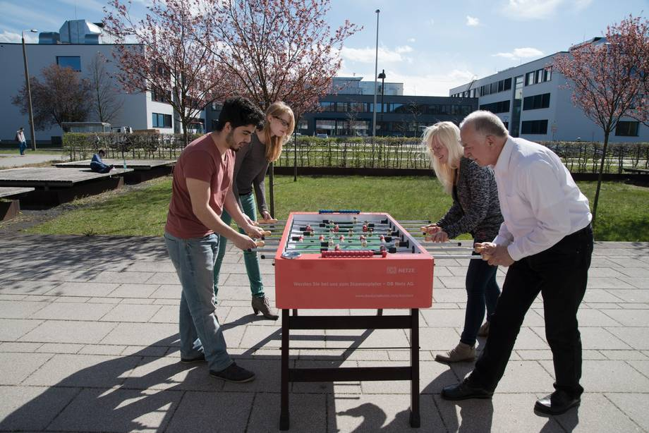 Members of the university playing table soccer